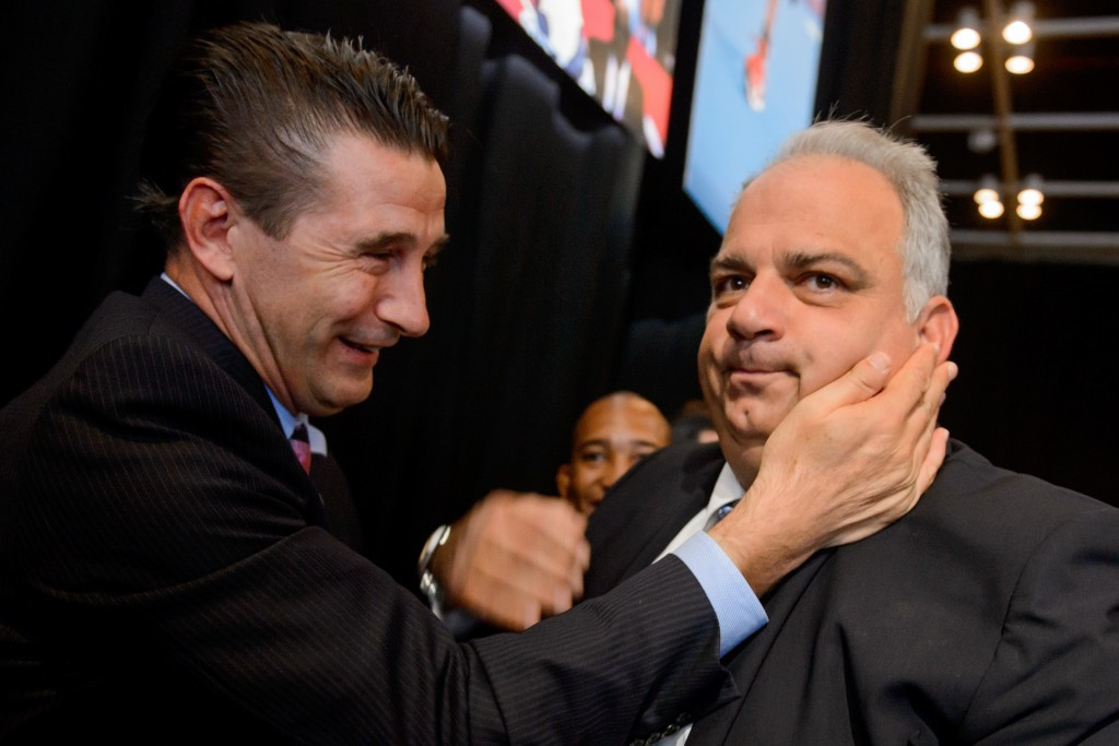 Nenad Lalovic (right) being congratulated by US actor and wrestling supporter, William Baldwin, after the sport was returned to the Olympic programme at the IOC Session in Buenos Aires ©Getty Images