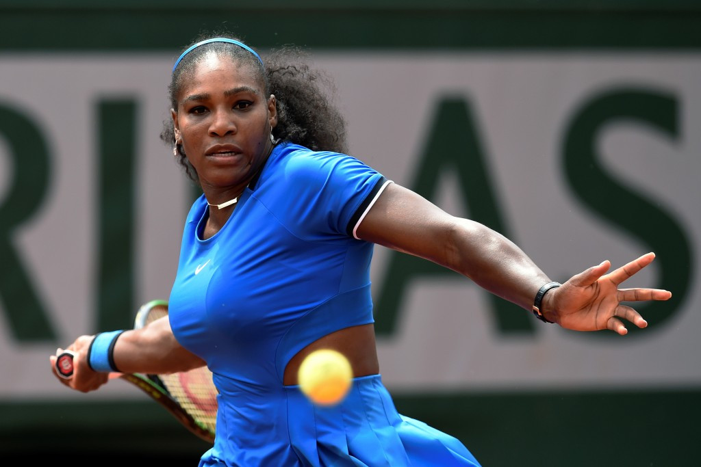 Defending champion Serena Williams was unaffected by a rain delay as she beat Kristina Mladenovic in straight sets