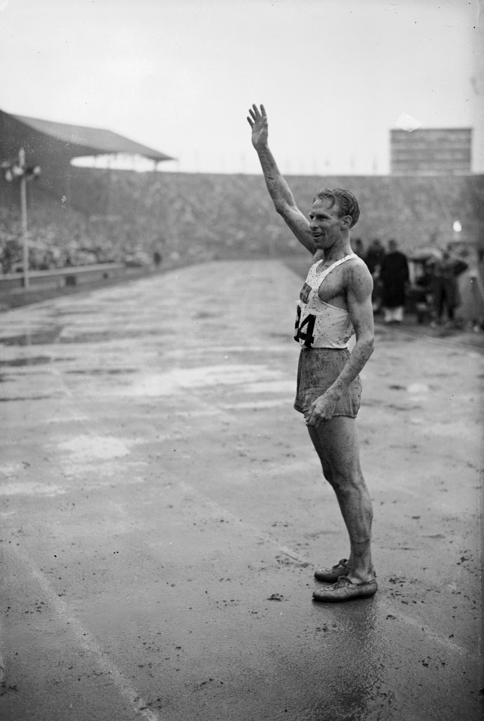 Henry Eriksson, Sweden's 1,500m gold medallist at the 1948 London Games,  helped carry the flame