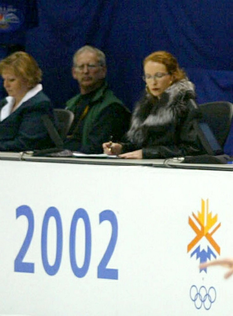 French judge Marie-Reine Le Gougne (right) consults her notes during the ice skating pairs final at the 2002 Salt Lake Games. She was later suspended for misconduct  ©Getty Images