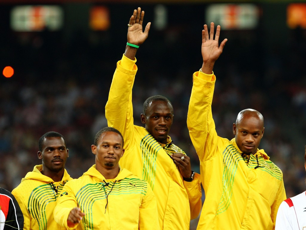 Nesta Carter (left) celebrating gold with his Jamaican team-mates at Beijing 2008 ©Getty Images