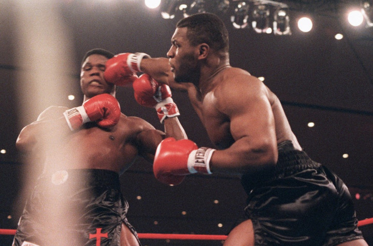 Trevor Berbick, pictured (left) losing his world heavyweight title to Mike Tyson in 1986, received a five-year sentence for sexual assault in 1992 V