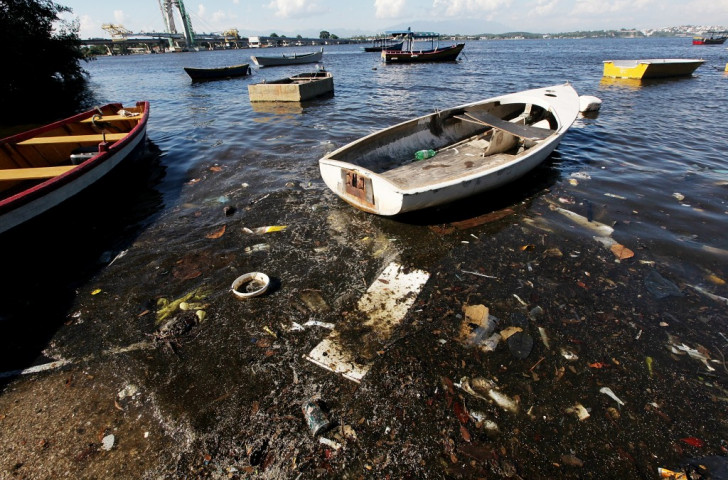 """Protesters slam wasted """"one billion dollars"""" to tackle pollution on Guanabara Bay in Rio de Janeiro"""