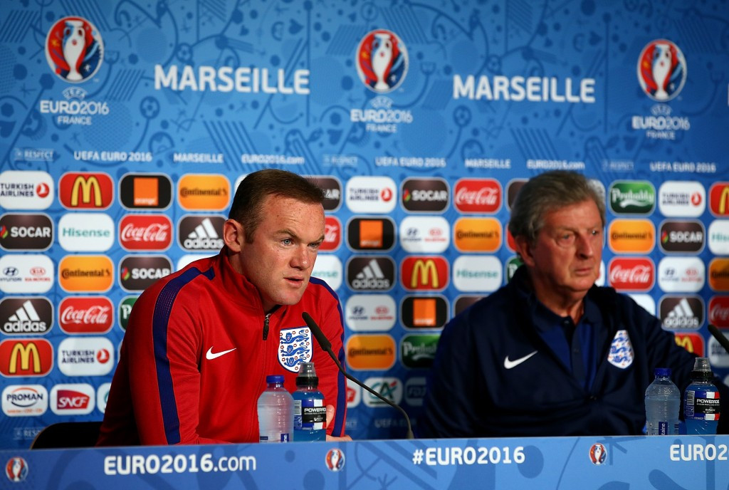 England captain Wayne Rooney (left) and manager Roy Hodgson (right) have appealed for fans to behave