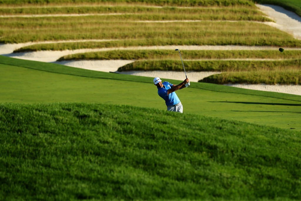 Johnson holds clubhouse lead at US Open after completing two rounds in single day