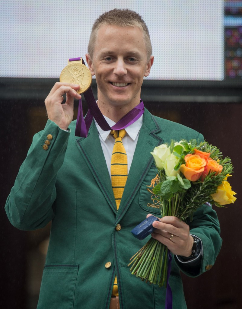 Jared Tallent with the Olympic gold medal for the London 2012 50km walk which he received at a public ceremony in Melbourne on Friday ©Getty Images