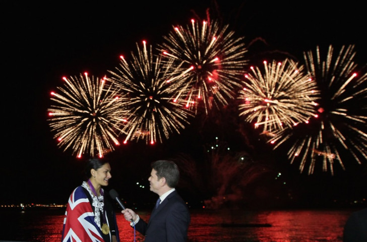 Valerie Adams is interviewed after her medal ceremony at Auckland Harbour in 2012 as fireworks go off in the background to mark her feat  ©Getty Images