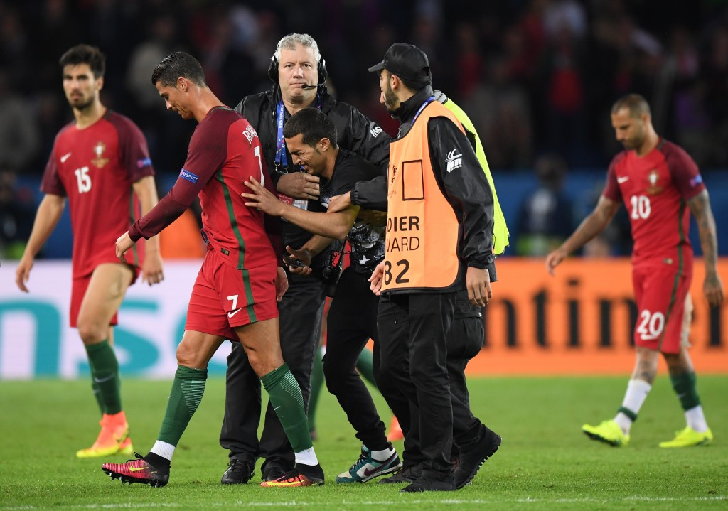 Portugal have been charged after one of their fans invaded the pitch to have a photo with their captain Cristiano Ronaldo