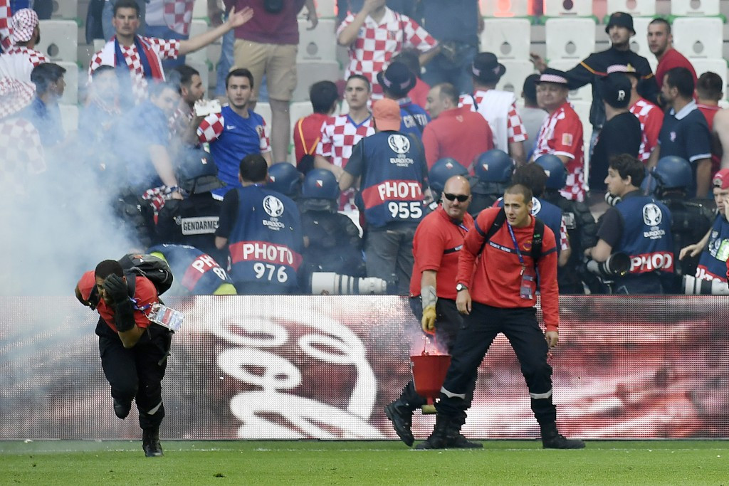 UEFA fine Croatian Football Federation and threaten ticket sanctions following fan violence in draw with Czech Republic