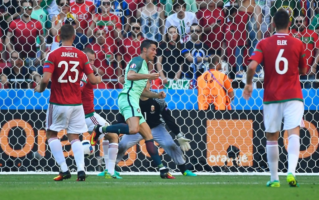 Cristiano Ronaldo scored twice to help Portugal reach the last 16 after a thrilling draw with Hungary