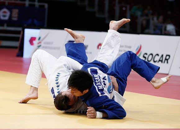 Adrian Gomboc was another athlete to secure their maiden IJF title as the Slovenian brought a halt to the Japanese dominance with victory over Masaya Asari ©IJF