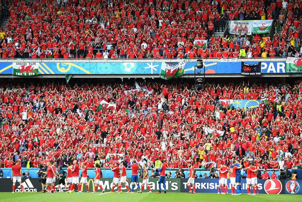 Wales fans celebrate after their team beat Northern Ireland 1-0 to reach the quarter-finals of Euro 2016 ©Getty Images