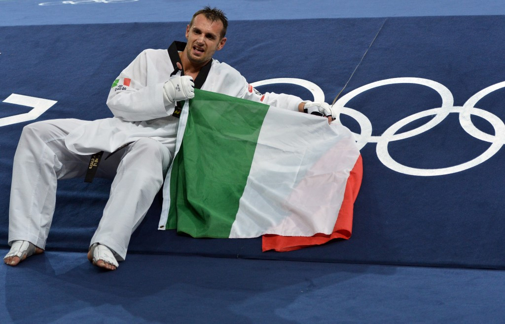 Carlo Molfetta, celebrating his Olympic gold medal at London 2012, has been voted as one of two athlete representatives of the FITA Federal Council ©Getty Images