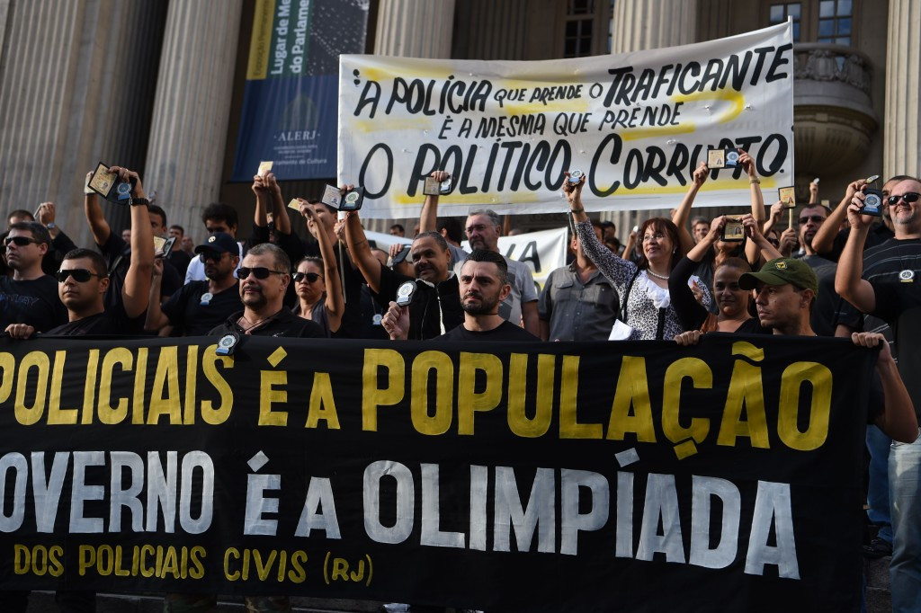 "Rio police hold up signs welcoming tourists ""to hell"" as strikes threatened during Olympics and Paralympics"