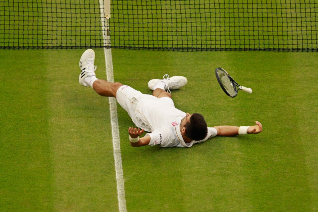 Novak Djokovic lies on the floor after playing a shot against Adrian Mannarino ©Getty Images