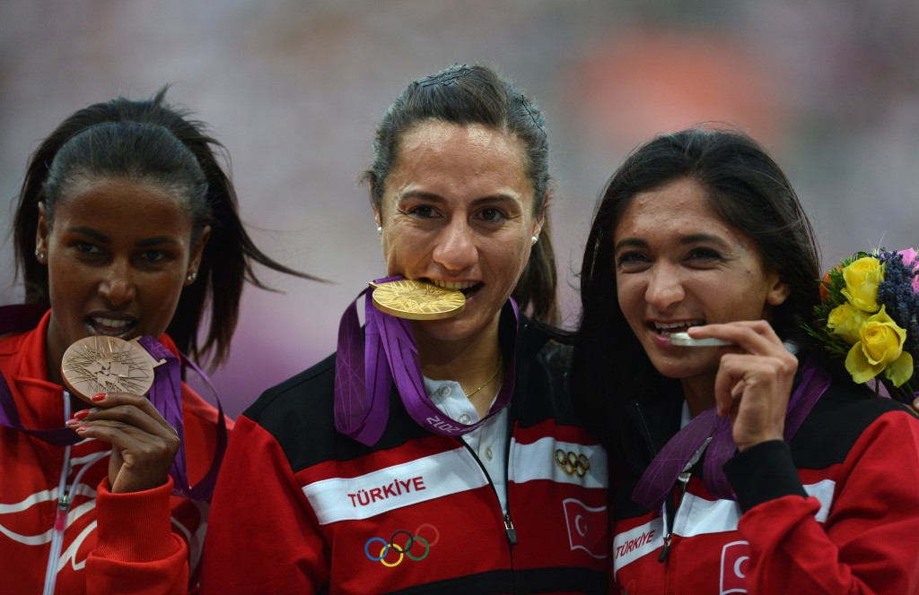 Turkey's Aslı Çakır Alptekin celebrating the Olympic gold medal she won at London 2012 but has subsequently been stripped of because of doping allegations ©Getty Images