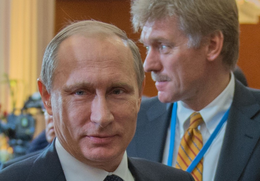 Russian Presidential spokeman Dmitry Peskov (right), pictured here with Vladimir Putin, says Vitaly Mutko is not mentioned as an actual perpetrator in WADA's report ©Getty Images