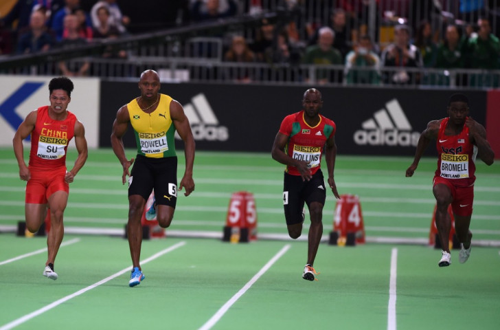 Kim Collins, pictured second right at the IAAF World Indoor Championships in Portland, Oregon, has been cleared to compete in his fifth Olympics after healing a rift with the St Kitts and Nevis Olympic Committee ©Getty Images