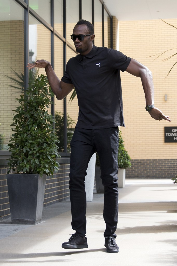 A perky Usain Bolt poses for photographers before today's press conference for the Muller Anniversary Games in London ©Getty Images