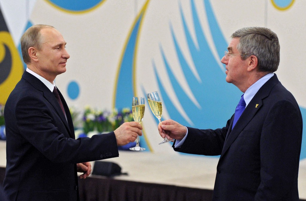 Vladimir Putin (left) was among the first to congratulate Thomas Bach after his election as IOC President ©Getty Images