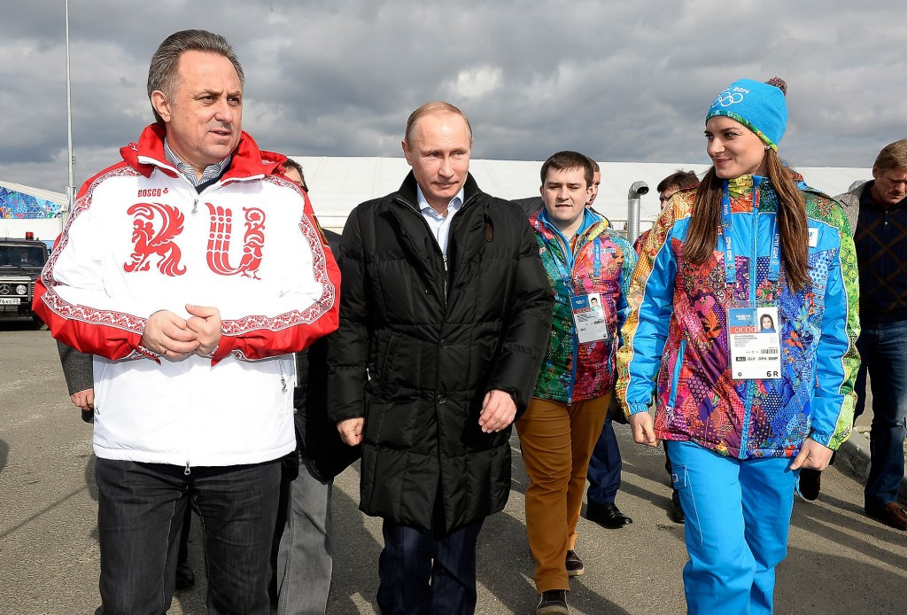 Double Olympic pole vault champion Yelena Isinbayeva, right, alongside Russian President Vladimir Putin and then Sports Minister Vitaly Mutko, left, who is now the Deputy Prime Minister, at Sochi 2014 ©Getty Images