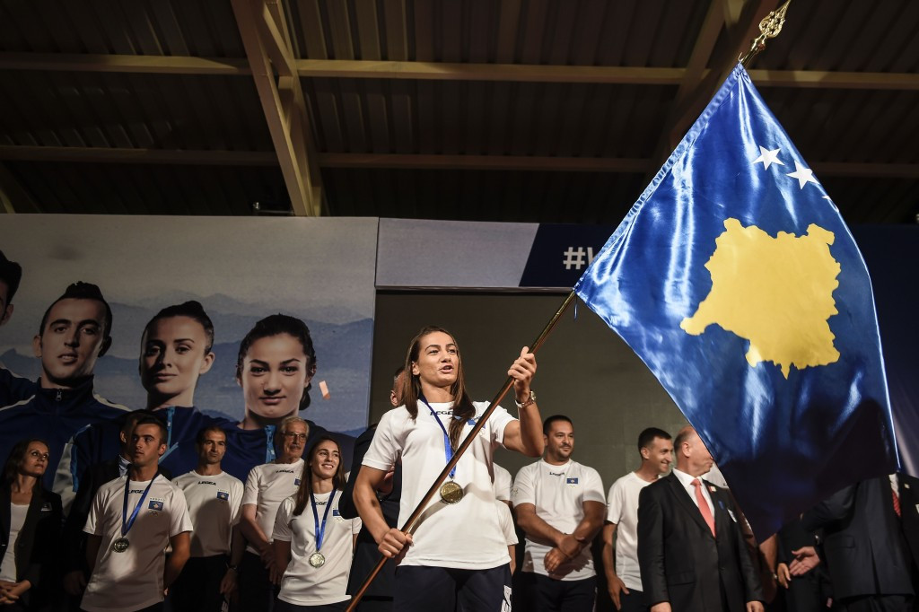 Kosovo judoka and gold medal hope Majlinda Kelmendi practices her flagwaving duties with one week to go ©Getty Images