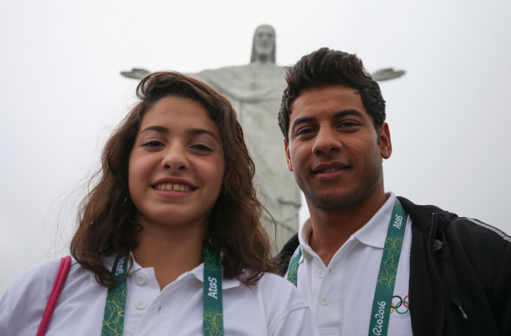 Yusra Mardini and fellow Syrian swimmer Rami Anis pose for the camera after arriving in Rio to compete for the Refugee Olympic Team ©Getty Images