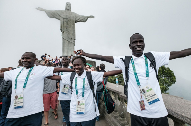 Yiech Pur Biel (right), Rose Nathike Lokonyen and their coach Joseph Domongole get the feel of Rio after arriving as part of the Refugee Olympic Team ©Getty Images