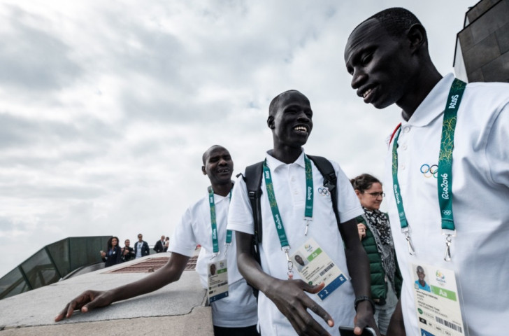 Refugee Olympic Team runners Yiech Pur Biel (centre) and James Chiengjiek (right) along with their Kenyan coach Joseph Domongole (left) get the feel of Rio, where they will compete on the track. ©Getty Images