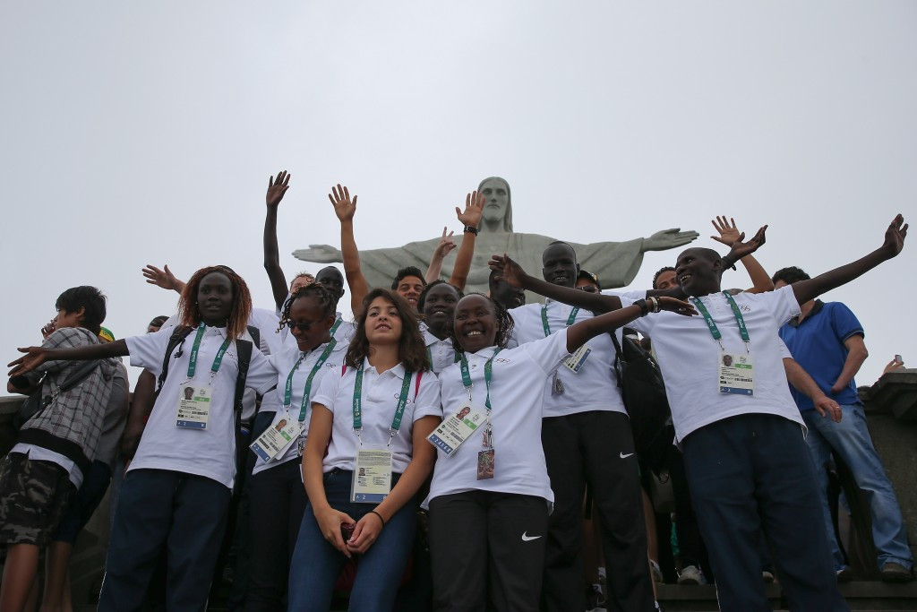 Members of the Refugee Olympic Team pose for a photo in front of the Christ the Redeemer statue ©Getty Images