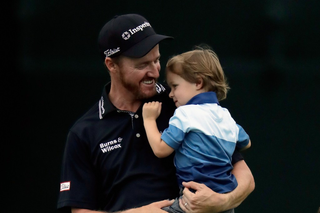 Jimmy Walker celebrates with his son following his victory ©Getty Images
