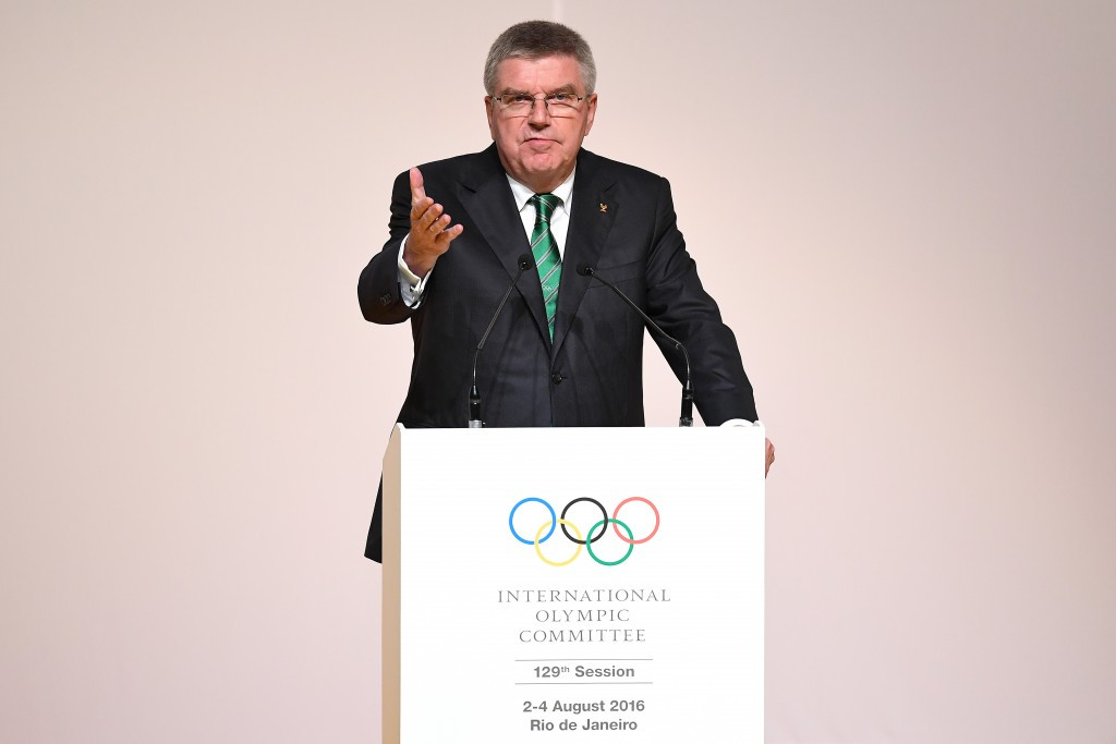 Bach defends handling of Russian crisis at low-key IOC Session Opening Ceremony