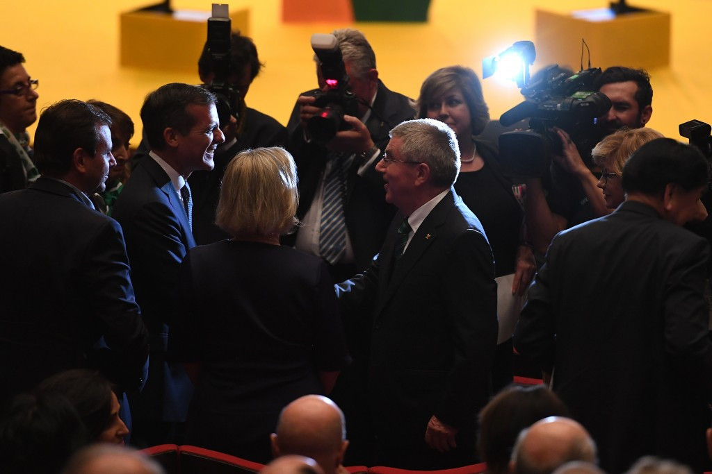 Thomas Bach greets Rio Mayor Eduardo Paes at the opening of the 129th IOC Session ©Getty Images