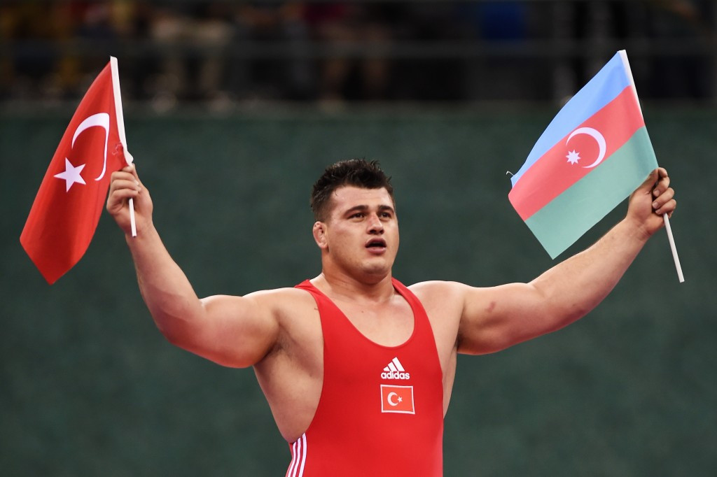 Riza Kayaalp clinched gold for Turkey but earned the acclaim of the crowd by holding both a Turkish and Azeri flag in celebration