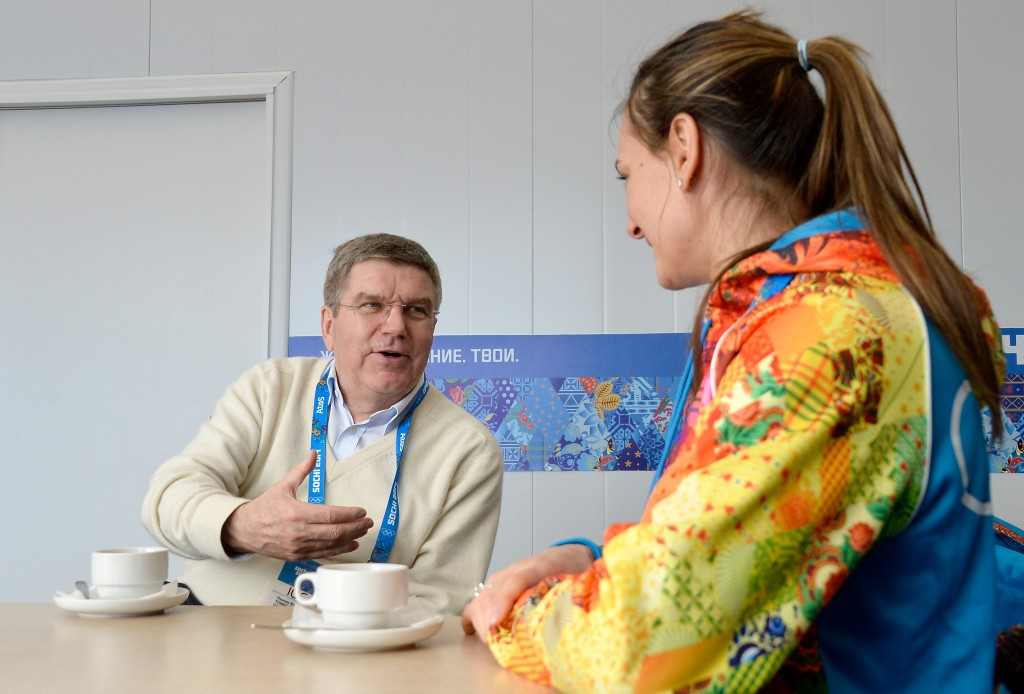 IOC President Thomas Bach pictured with Yelena Isinbayeva during Sochi 2014, where she was the Mayor of the Olympic Villae, despite being criticised for defending Russia's controversial anti-gay law ©Getty Images