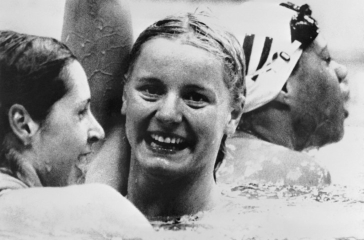 Kornelia Ender of East Germany celebrates victory in the 200m freestyle at the 1976 Montreal Olympics ahead of Shirley Babashoff (left) ©Getty Images