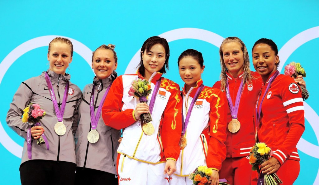 Wu Minxia, centre left, celebrates her gold medal in the synchronised 3m springboard at London 2012 with partner He Zi, centre right, who she will also compete with at Rio 2016 ©Getty Images
