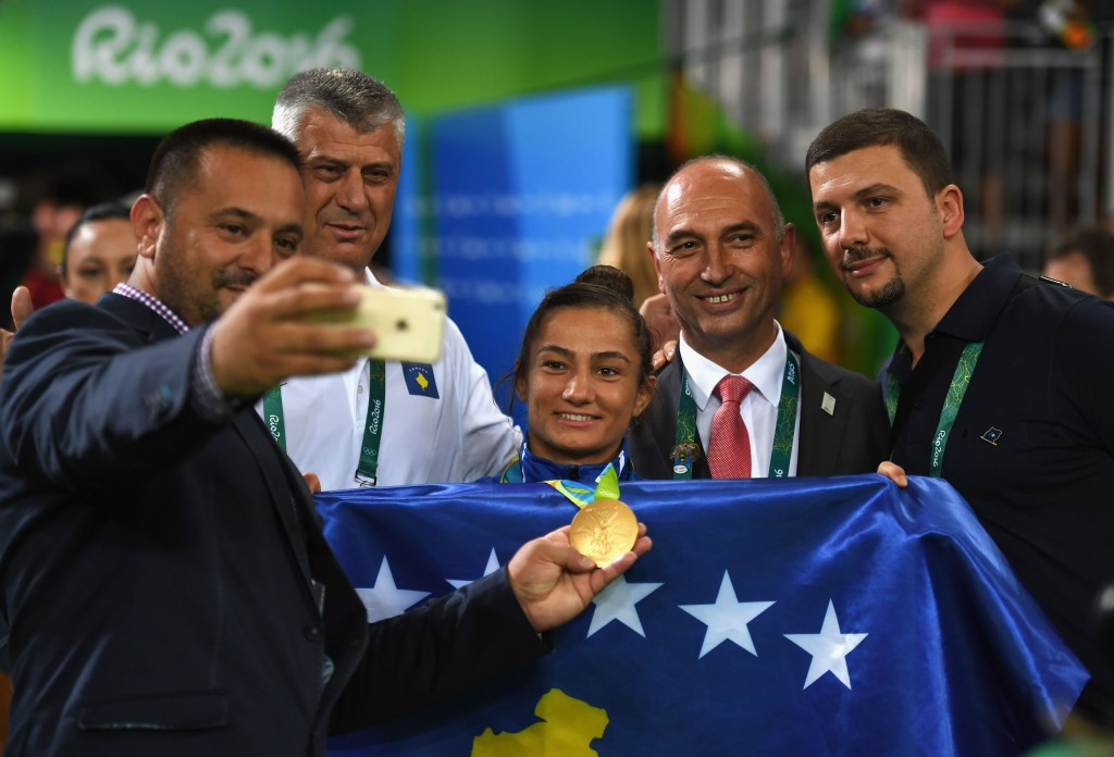Majlinda Kelmendi celebrates her historic gold medal with supporters, including second right, Kosovan Olympic Committee President Besim Hasani ©Getty Images