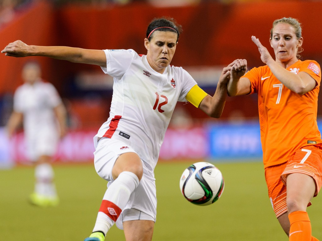 Hosts Canada are also through despite being held to a 1-1 draw by The Netherlands