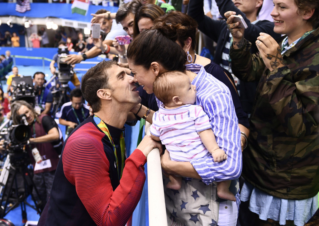 Michael Phelps celebrates with his family after winning the 200m butterfly title ©Getty Images