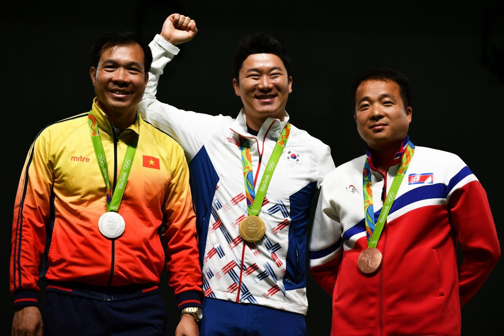 It was an all Asian medal podium in the 50 metre pistol as Vietnam's Hoang Xuan Vinh, left, claimed the silver medal and North Korea's Kim Song Guk, right, the bronze ©Getty Images