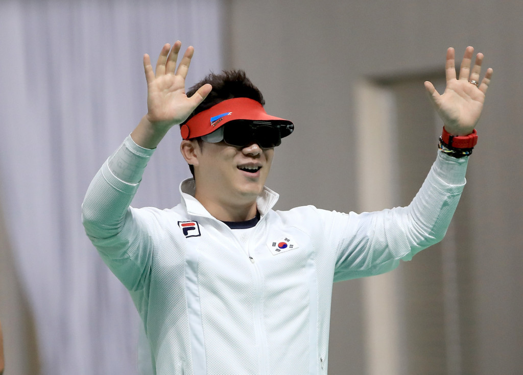 Jin Jongoh became the first athlete to win three shooting gold medals in a row as he won the men's 50m pistol final ©Getty Images