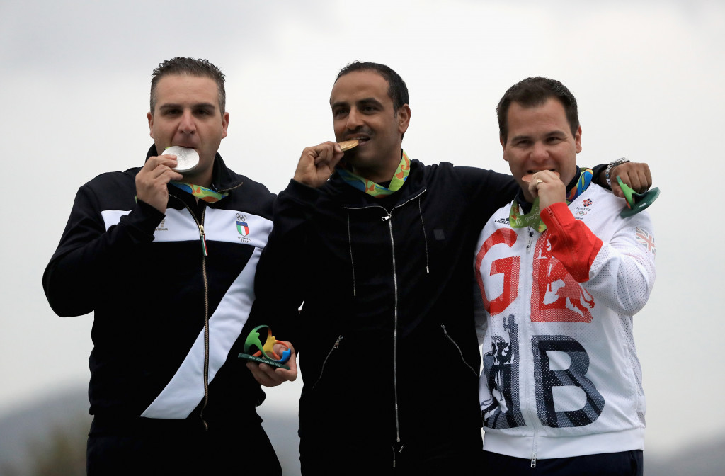 Kuwait's Fehaid Al-Deehani, representing the Independent Olympic Athletes, celebrates his gold medal with Italy's Marco Innocenti, left, and Britain's Steve Scott, right, who won the silver and bronze ©Getty Images