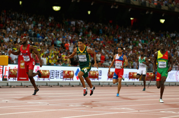 Wayde van NIekerk of South Africa will be seeking to reproduce his world 400m title win of last year in Beijing, where he headed LaShawn Merritt (left) and Kirani James (right) as all three broke 44sec ©Getty Images
