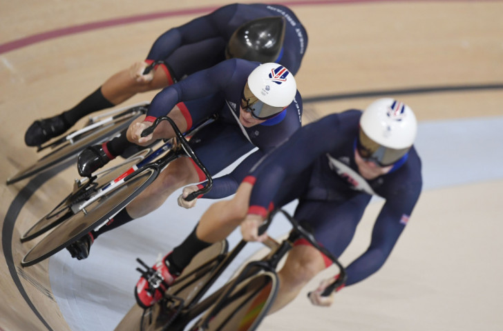 Britain's Philip Hindes, Jason Kenny and Callum Skinner at full pelt en route to team sprint gold at the Rio Olympic Velodrome on the first day of cycling's track programme ©Getty Images