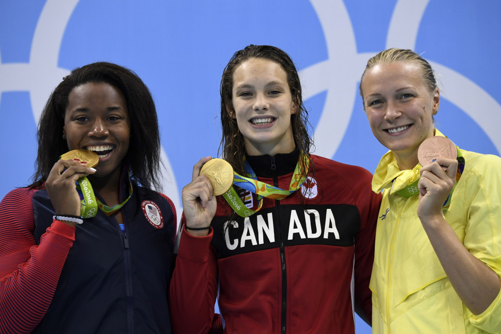 Simone Manuel (left) became the first black female to win an Olympic swimming gold ©Getty Images