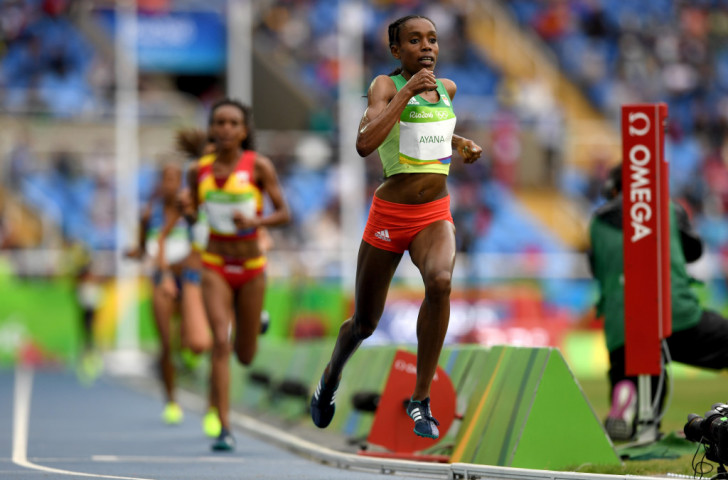 Almaz Ayana of Ethiopia strides out en route to her Olympic 10,000m victory in a world record of 29:17.54 on the opening morning of the Rio 2016 athletics programme  ©Getty Images
