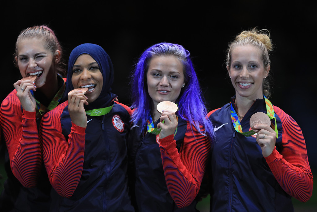 Ibtihaj Muhammad (second left) became the first American wearing a hijab to claim an Olympic medal ©Getty Images
