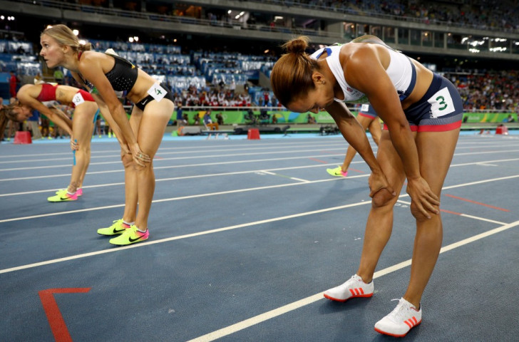 Jessica Ennis-Hill (right) has given everything in winning the concluding 800m of the heptathlon - but she knows it has not been enough to prevent Belgium's 21-year-old Nafi Thiam from taking the title she won in London 2012 ©Getty Images