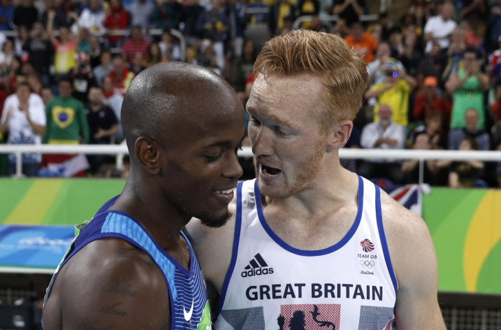 Olympic champions present and past - London 2012 long jump champion Greg Rutherford, who took bronze here, congratulates Jeff Henderson of the United States who claimed the Rio 2016 title with his last attempt ©Getty Images